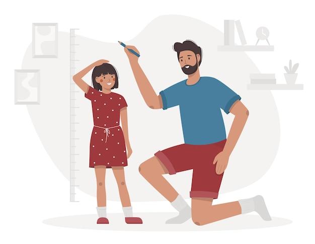Ojciec mierzy wzrost dziecka. córka i tata w pokoju zaznaczają wysokość na ścianie licznika