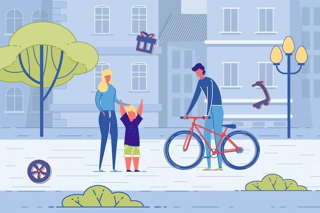 Ojciec rozdaje prezent rowerowy synowi na ulicy