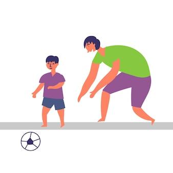 Ojciec syn spędza czas razem grając w piłkę nożną