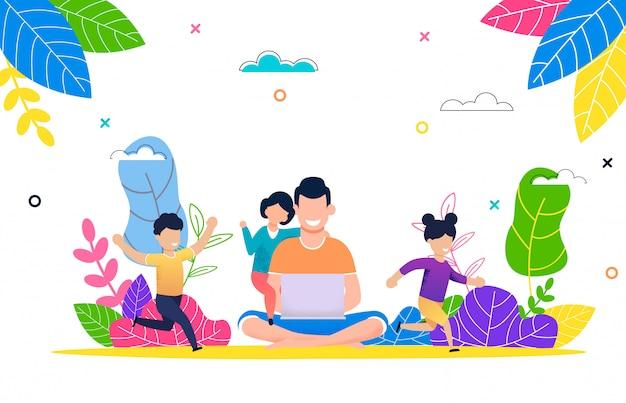 Ojciec z dziećmi ogląda filmu laptop w parku