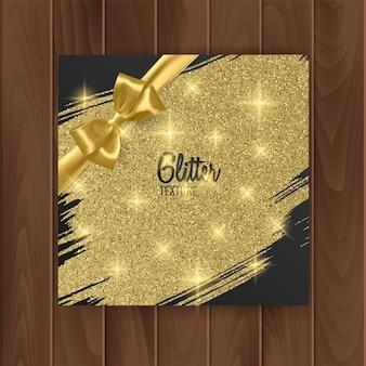 Okładka karty upominkowej ze złotą błyszczącą teksturą i złotą kokardką.
