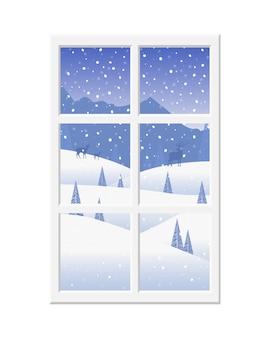 Okno z białą ramą z widokiem na piękny zimowy krajobraz i jelenie.