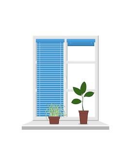 Okno z parapetem i białą ramką i niebieskimi roletami
