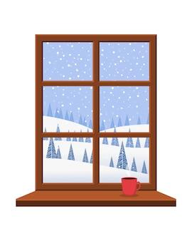 Okno z parapetem i brązową ramą z widokiem na piękny zimowy krajobraz.
