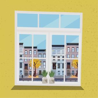 Okno z widokiem domów na ulicy. jesienne wnętrze. słoneczna dobra pogoda na zewnątrz.
