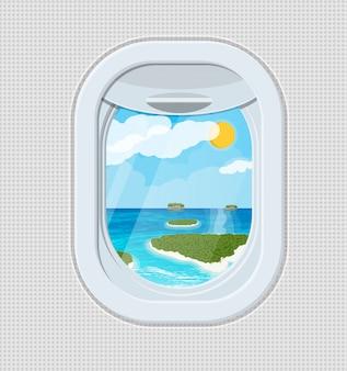 Okno z wnętrza samolotu z wyspą