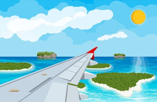 Okno z wnętrza samolotu z wyspami
