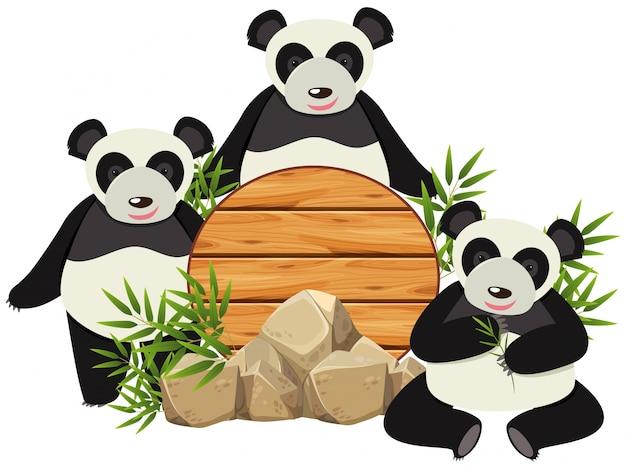 Okrągła deska z trzema uroczymi pandami