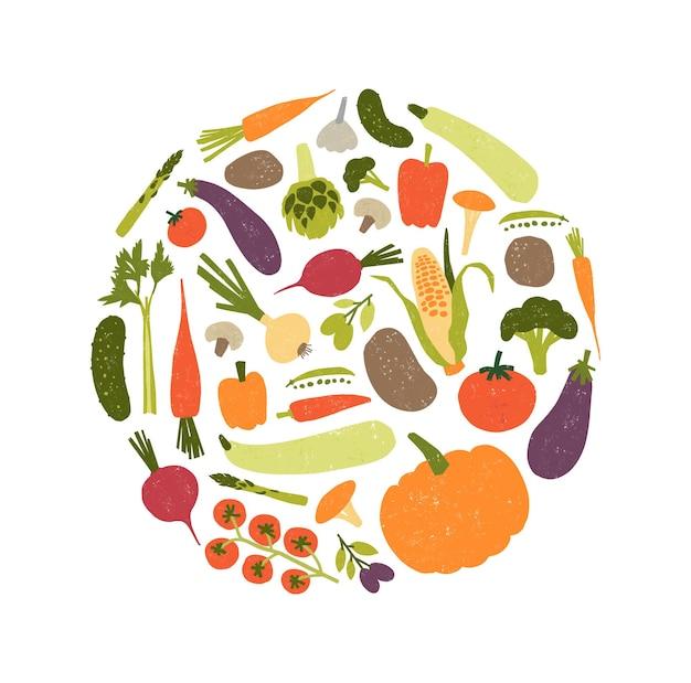 Okrągła kompozycja dekoracyjna ze świeżymi surowymi dojrzałymi warzywami lub zebranymi plonami