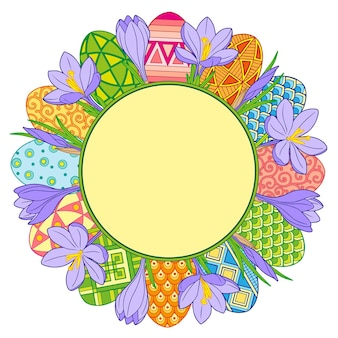 Okrągła rama wykonana z jasnych pisanek i kwiatów krokusów