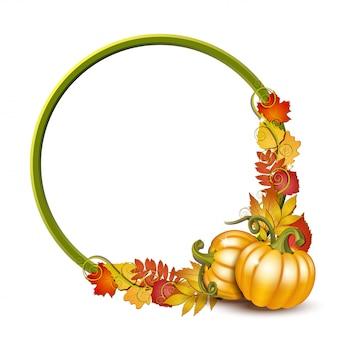 Okrągła rama z pomarańczowymi dyniami i jesiennymi liśćmi klonu