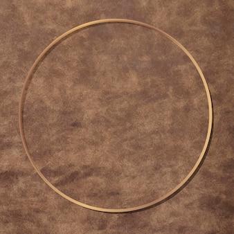 Okrągła złota rama na brązowym skórzanym tle wektora