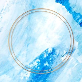 Okrągła złota rama na niebieskim tle malowanej tekstury texture