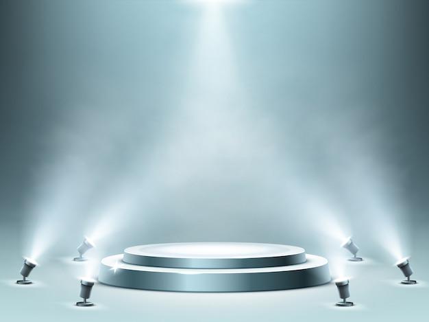 Okrągłe podium z efektem dymu i reflektorami