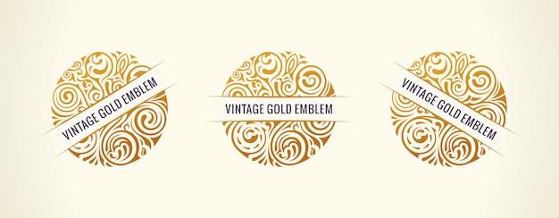 Okrągłe złote emblematy