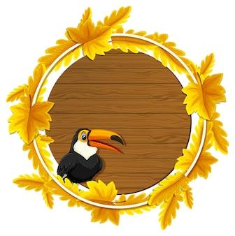 Okrągły szablon transparentu jesiennych liści z postacią z kreskówki tukana