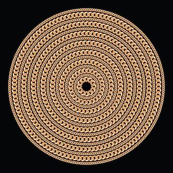 Okrągły wzór wykonany ze złotych łańcuchów.
