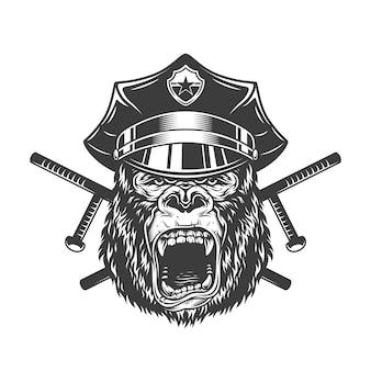 Okrutna głowa goryla w czapce policyjnej