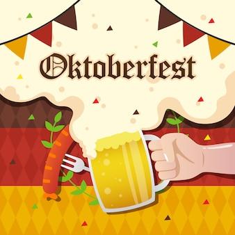 Oktoberfest z ręki trzymającej kubek z kiełbasą