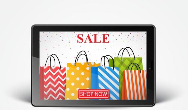 Online sprzedaż ze smartfonem i kolorowymi torbami na zakupy