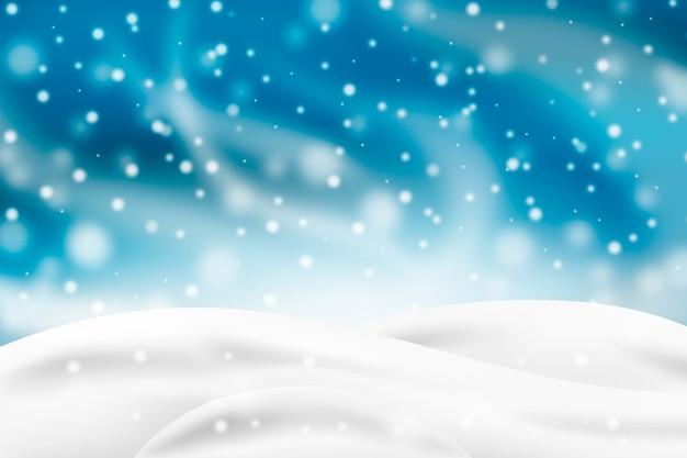 Opad śniegu burza z białym wzgórza tłem