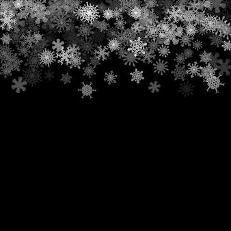 Opad śniegu z losowymi płatkami śniegu w ciemności
