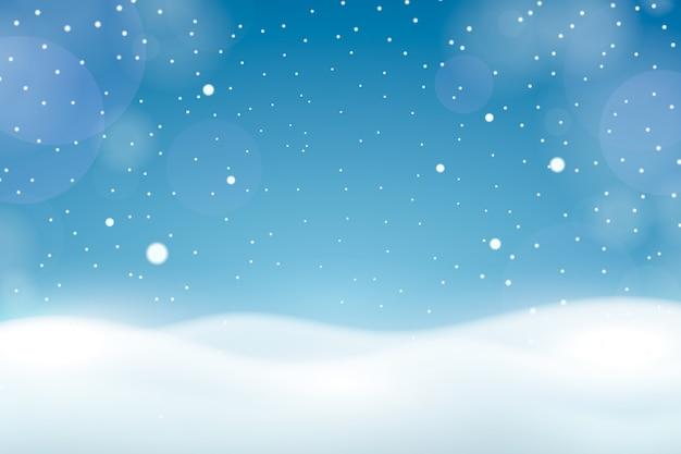 Opad śniegu z tapetą bokeh