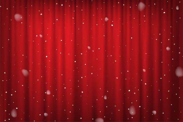 Opady śniegu na tle czerwonej kurtyny, szablon plakatu zimowego kina, teatru lub cyrku.