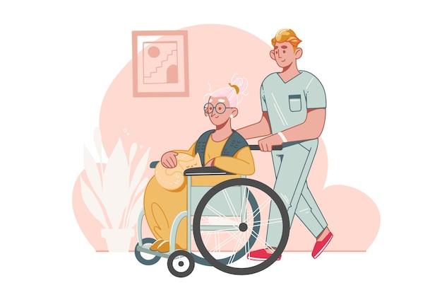 Opieka nad osobami starszymi . pracownik socjalny lub wolontariusz pomaga starszej kobiecie poruszającej się na wózku inwalidzkim. pomoc dla seniorów niepełnosprawnych w domu opieki.