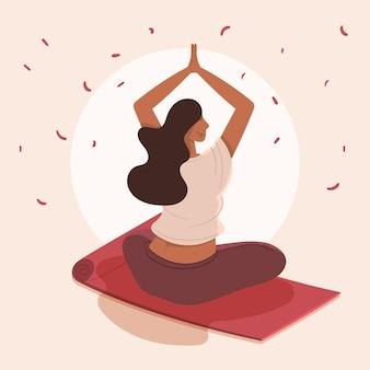 Organiczne mieszkanie kobieta medytuje na macie