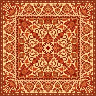 Orientalny czerwony dywan z granatem.