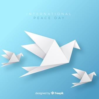Origami pokoju dnia tło z gołąbką