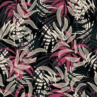 Oryginalny streszczenie wzór z kolorowych liści tropikalnych i roślin na ciemnym tle