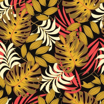 Oryginalny tropikalny wzór z jaskrawymi czerwonymi i żółtymi odcieniami