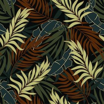 Oryginalny tropikalny wzór z jasnobrązowymi i żółtymi roślinami i liśćmi
