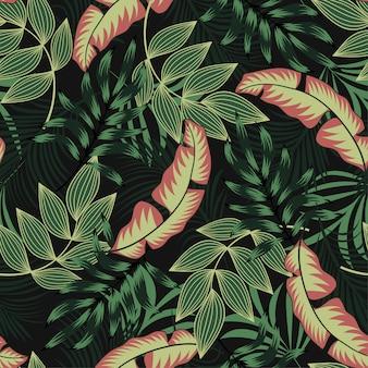 Oryginalny tropikalny wzór z jasnoróżowymi i zielonymi roślinami i liśćmi