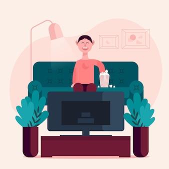 Osoba ciesząca się filmem z popcornem