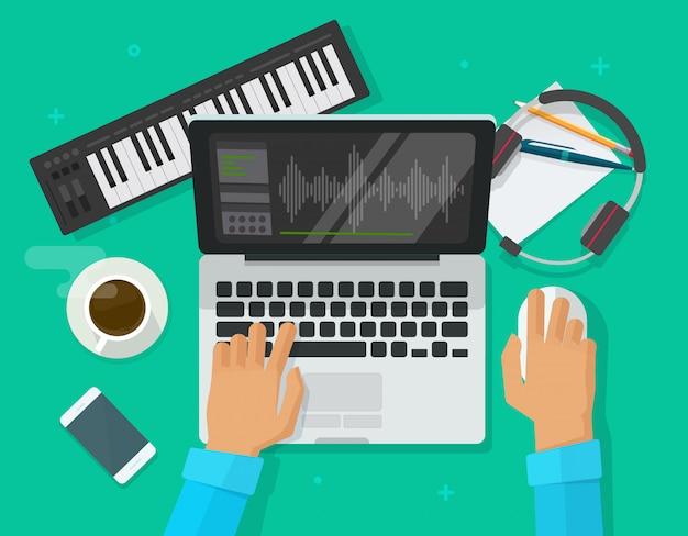 Osoba komponuje muzykę elektroniczną na komputerowym laptopie