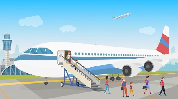 Osoby lądujące z samolotu na lotnisku. rozładunek.