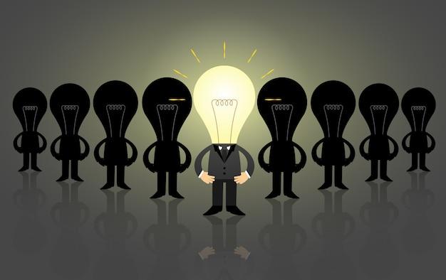 Oświetlony lider żarówki ze swoim personelem, koncepcja biznesowa