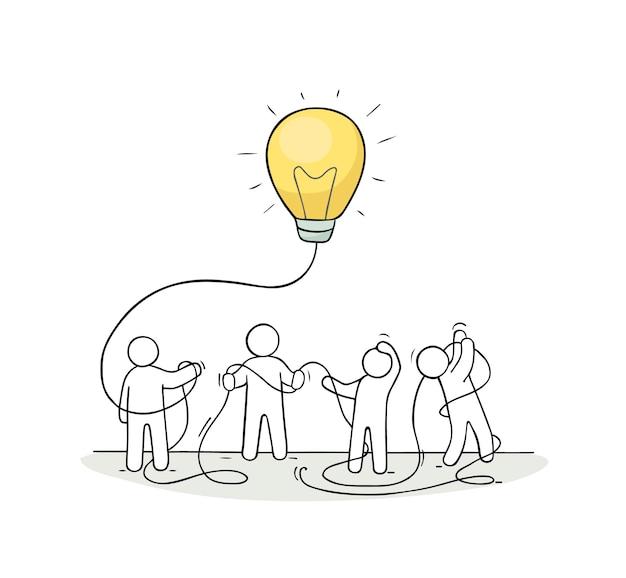 Otoczenie biznesu z ludźmi i lampa ide