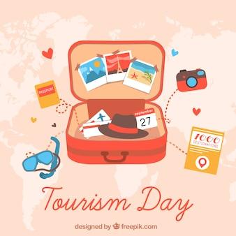 Otwarta walizka z elementami podróży, dzień turystyki światowej