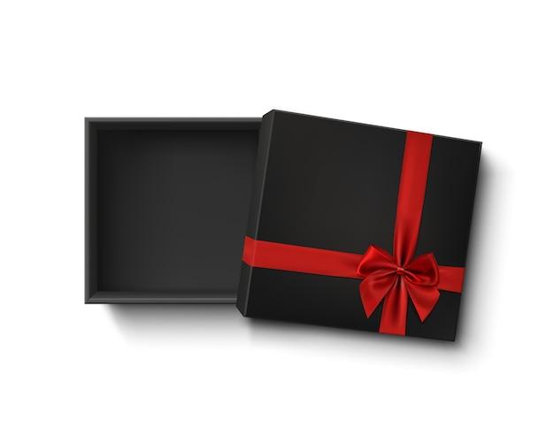 Otwarte czarne puste pudełko z czerwoną wstążką i łuk na białym tle. widok z góry. szablon do projektowania prezentacji, banerów, broszur lub plakatów.