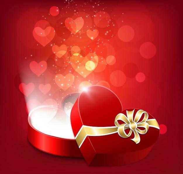 Otwarte czerwone pudełko w kształcie serca z latającymi sercami