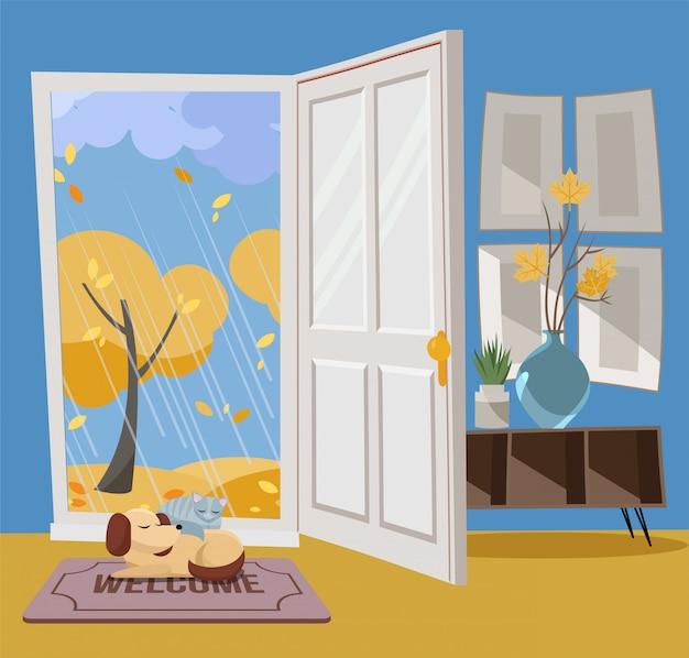 Otwarte drzwi w widok jesieni z żółtymi drzewami.