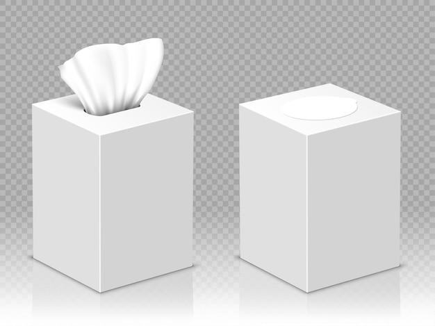 Otwarte i zamknięte pudełko z białymi papierowymi serwetkami