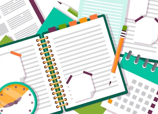 Otwarty notatnik lub pamiętnik z notatkami.