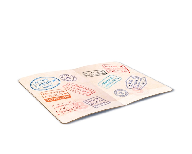 Otwarty zagraniczny paszport pełen znaczków imigracyjnych, dokument podróży w perspektywie na białym tle