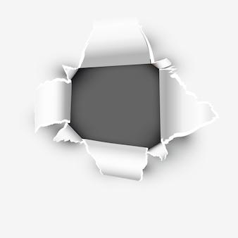 Otwór pokazujący przestrzeń w podartym papierze