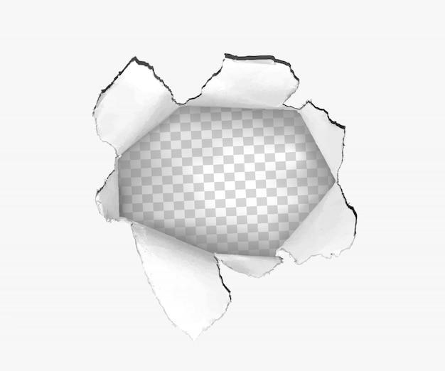 Otwór rozdarty w zgranym papierze na białym tle